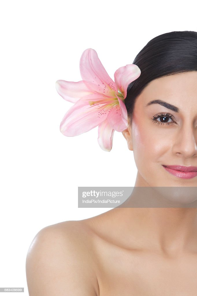 Portrait of a beautiful woman with flower in hair : Stock Photo