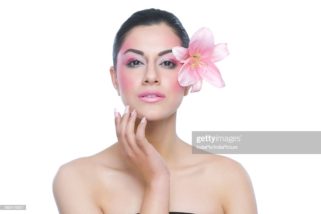 Portrait of a beautiful woman with flower : Stock Photo