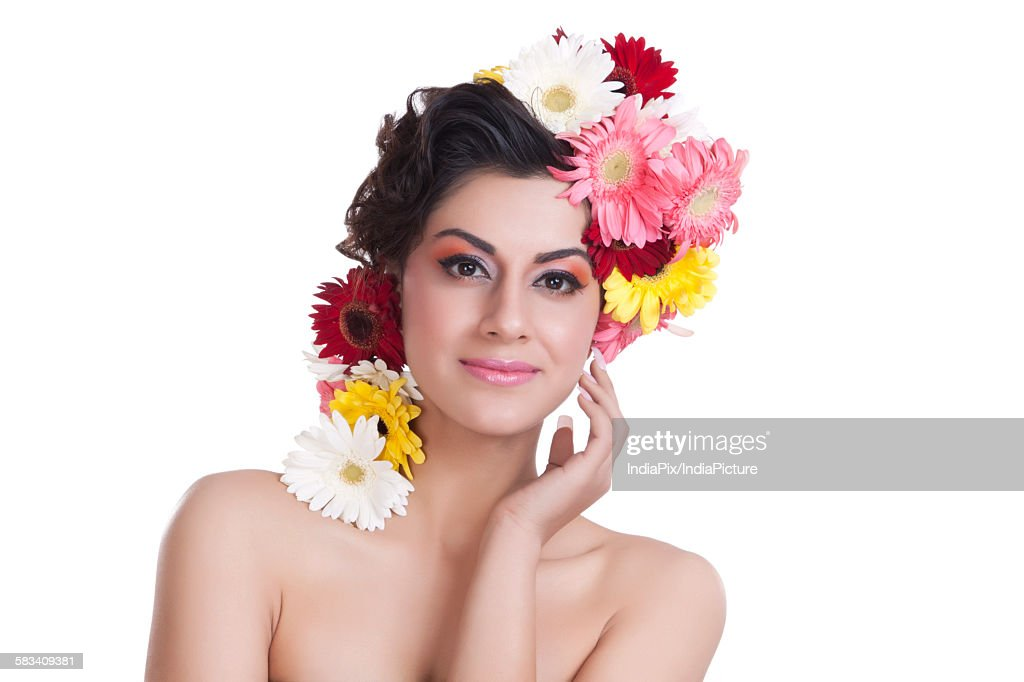 Portrait of a beautiful woman with flowers in hair : Stock Photo