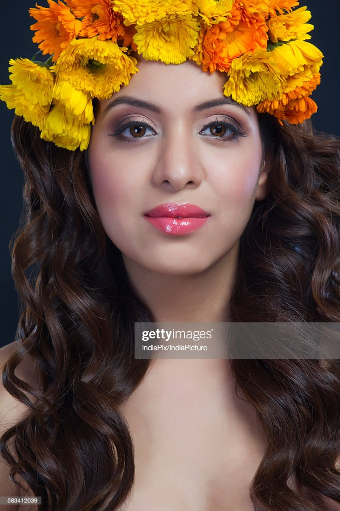 Portrait of a beautiful woman with flowers in her hair : Stock Photo