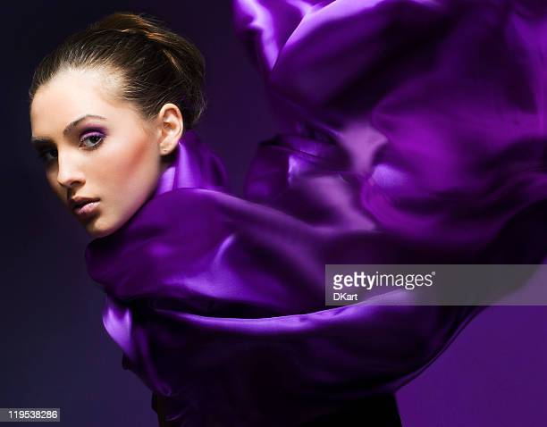 Portrait of a beautiful woman wrapped in purple satin cloth
