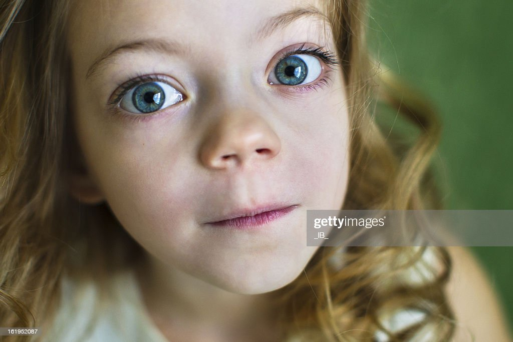 Portrait of a beautiful young girl with huge blue eyes : Stock Photo