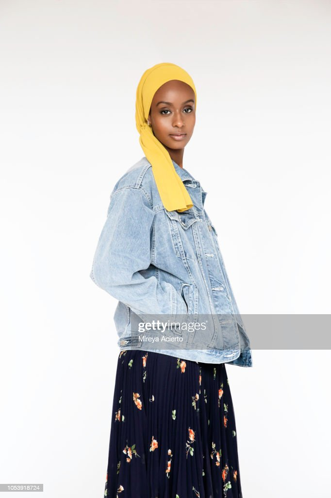 169140018f6 A Portrait Of A Beautiful Young Muslim Woman Wearing A Yellow Scarf ...