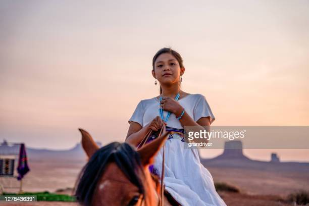 portrait of a beautiful young twelve year old navajo girl in traditional native american clothing posing in the desert near the monument valley tribal park in northern arizona at sunset or sunrise - navajo culture stock pictures, royalty-free photos & images
