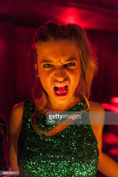 Portrait of a beautiful young woman at a night club