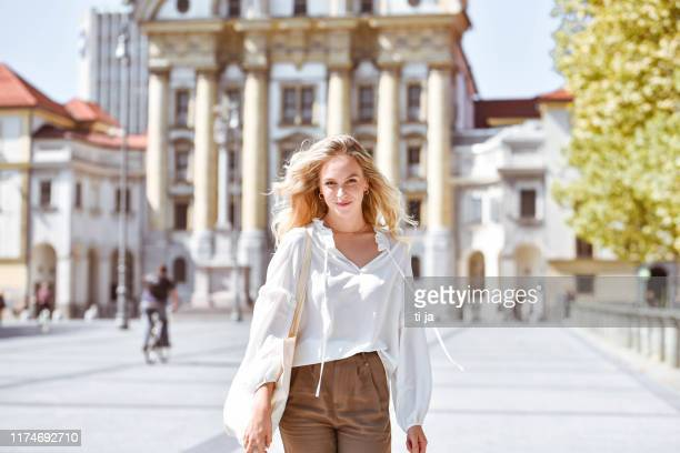 portrait of a beautiful young woman in a city - blouse stock pictures, royalty-free photos & images