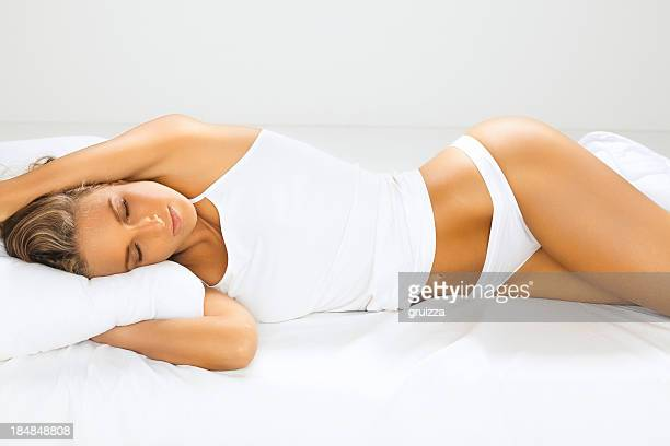 Portrait of a beautiful, young, woman sleeping in bed