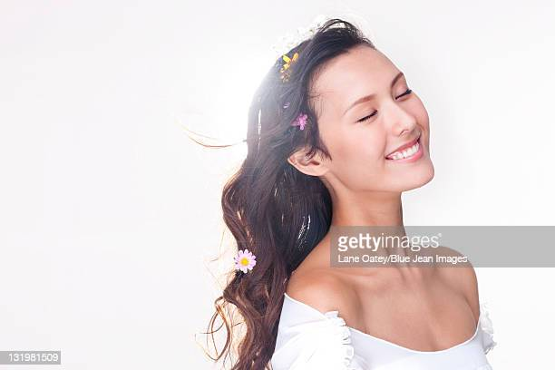 Portrait Of A Beautiful Young Woman With Flowers In Her Hair