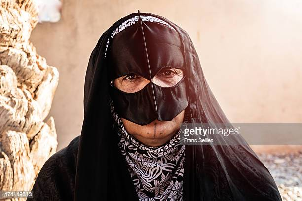 Portrait of a Bedouin woman visiting the animal market in Nizwa