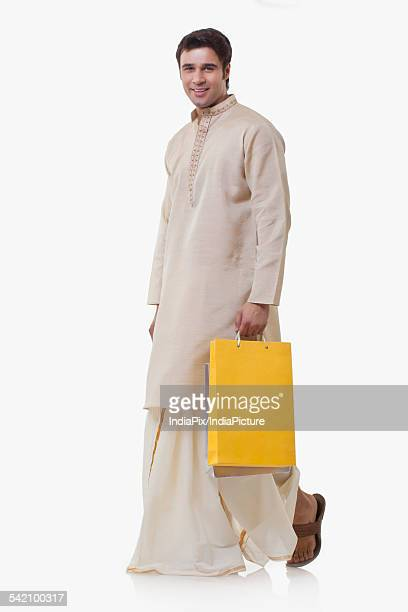 Portrait of a Bengali man holding shopping bags