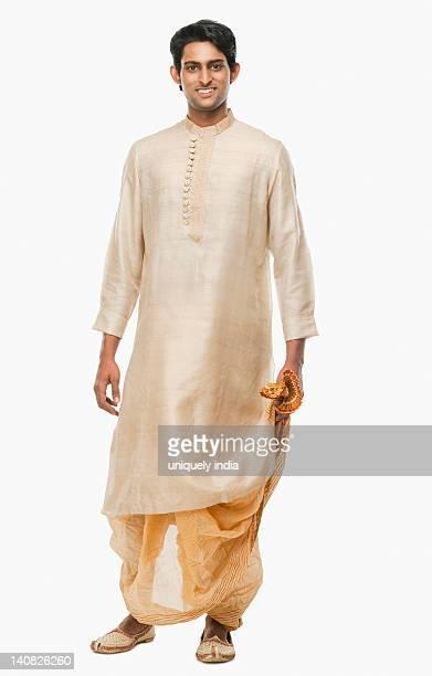 portrait of a bengali man smiling - kurta stock pictures, royalty-free photos & images
