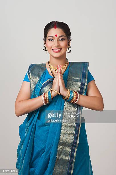 Portrait of a Bengali woman greeting and smiling
