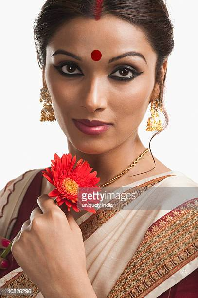 Portrait of a Bengali woman holding a Daisy flower