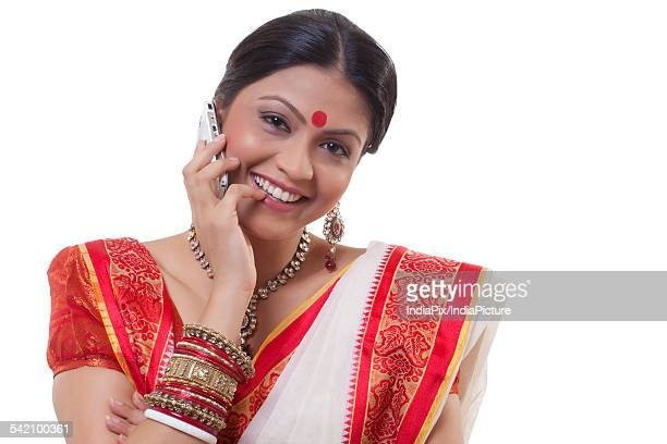 Portrait of a Bengali woman talking on a mobile phone