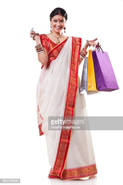 Portrait of a Bengali woman with shopping bags