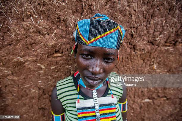 Portrait of a benna girl tribe with colorful necklaces and bracelets in key afer market, omo valley, ethiopia