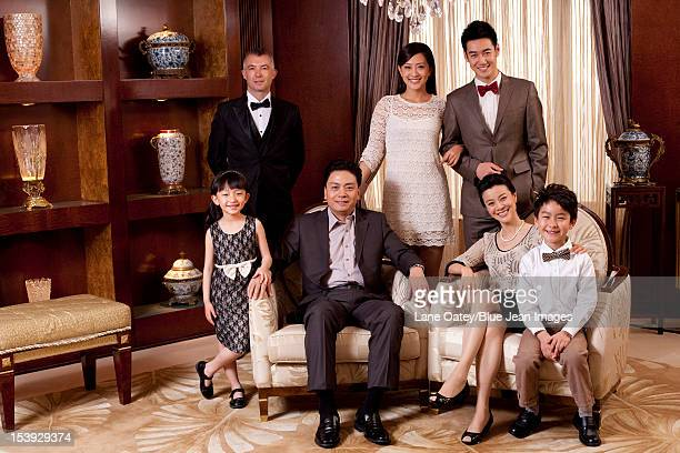 Portrait of a big family in a luxurious room