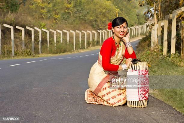 Portrait of a Bihu dancer with a dhol