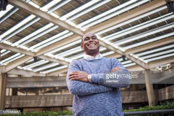 portrait of a black businessman - adamkaz stock pictures, royalty-free photos & images
