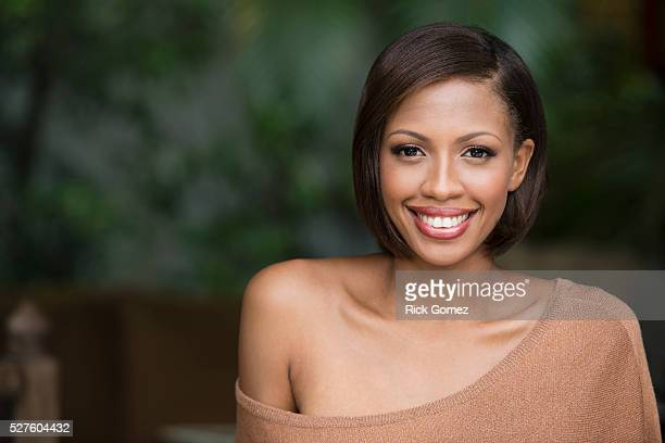 portrait of a black jamaican woman - off shoulder stock pictures, royalty-free photos & images