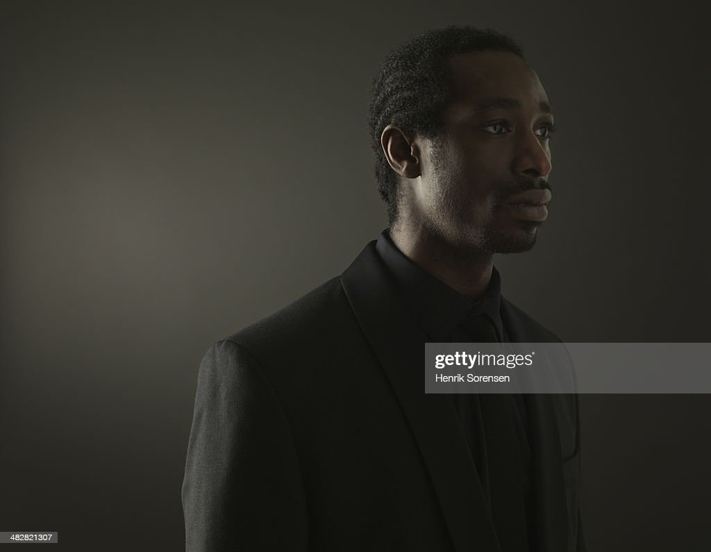 Portrait of a black man on a dark background : Stock Photo