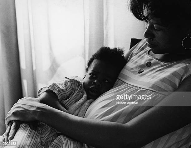 Portrait of a Black mother sitting with her young girl circa 1970