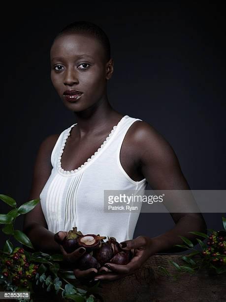 Portrait of a black woman holding fruit