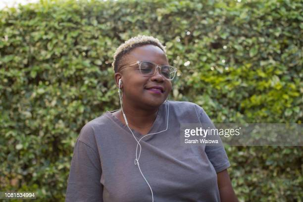 Portrait of a black woman listening to music outside