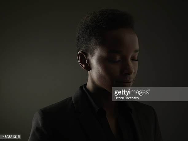 Portrait of a black woman on a dark backdrop