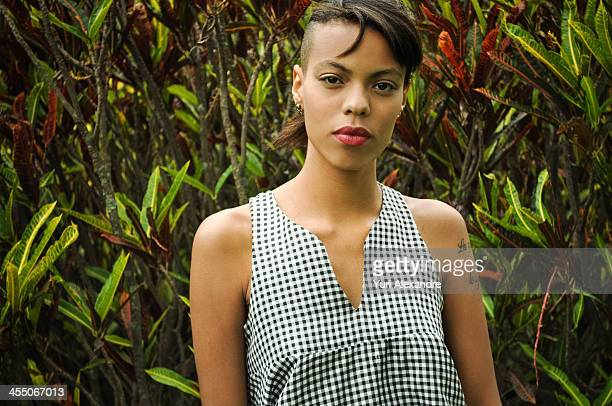 portrait of a black young lady posing to camera - half shaved hairstyle stock pictures, royalty-free photos & images