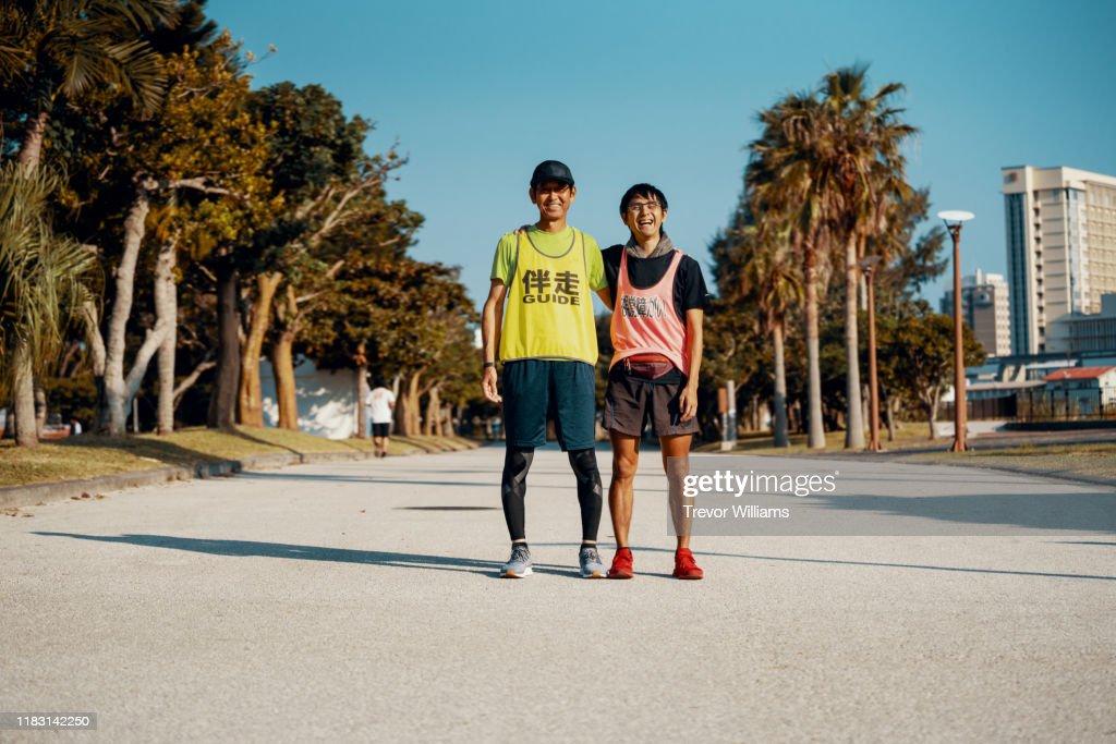 Portrait of a blind marathon athlete and his guide : ストックフォト