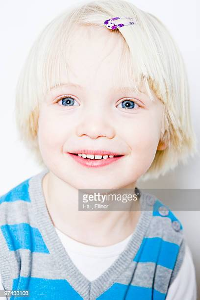 Portrait of a blond, happy boy, close-up.