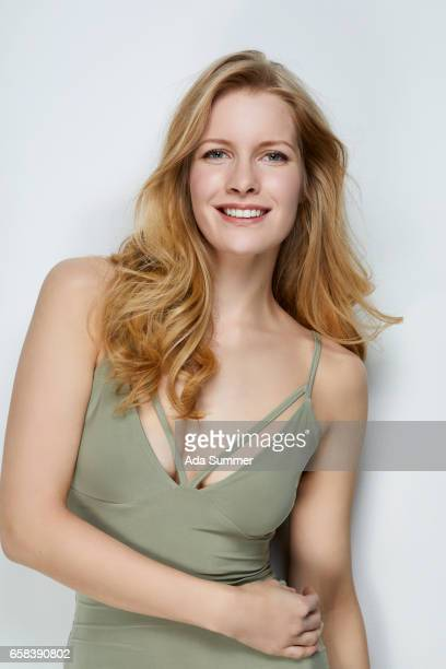 portrait of a blond smiling woman - waist up stock pictures, royalty-free photos & images