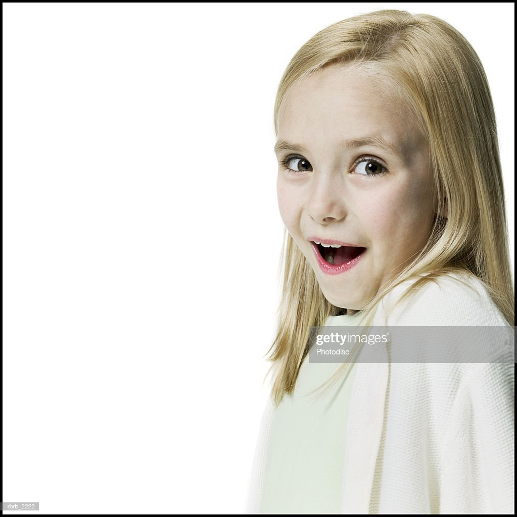 portrait of a blonde female child as she flashes a surprised look at the camera : Bildbanksbilder