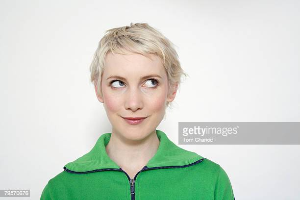 portrait of a blonde woman - looking up stock pictures, royalty-free photos & images