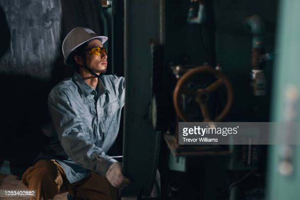 portrait of a blue collar factory worker in japan - japan stock pictures, royalty-free photos & images