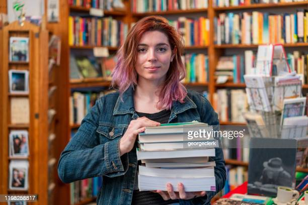 portrait of a bookstore employee - book shop stock pictures, royalty-free photos & images