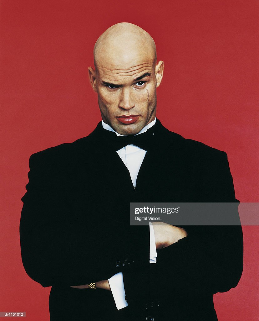 Portrait of a Bouncer With His Arms Crossed : Stock Photo