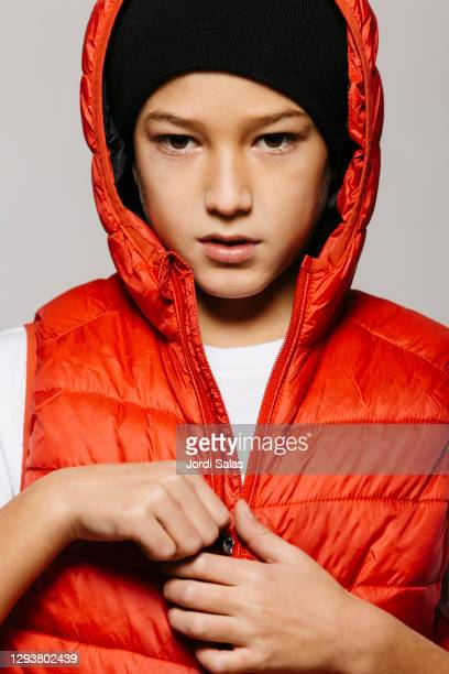 portrait of a boy against a grey background - jacket stock pictures, royalty-free photos & images