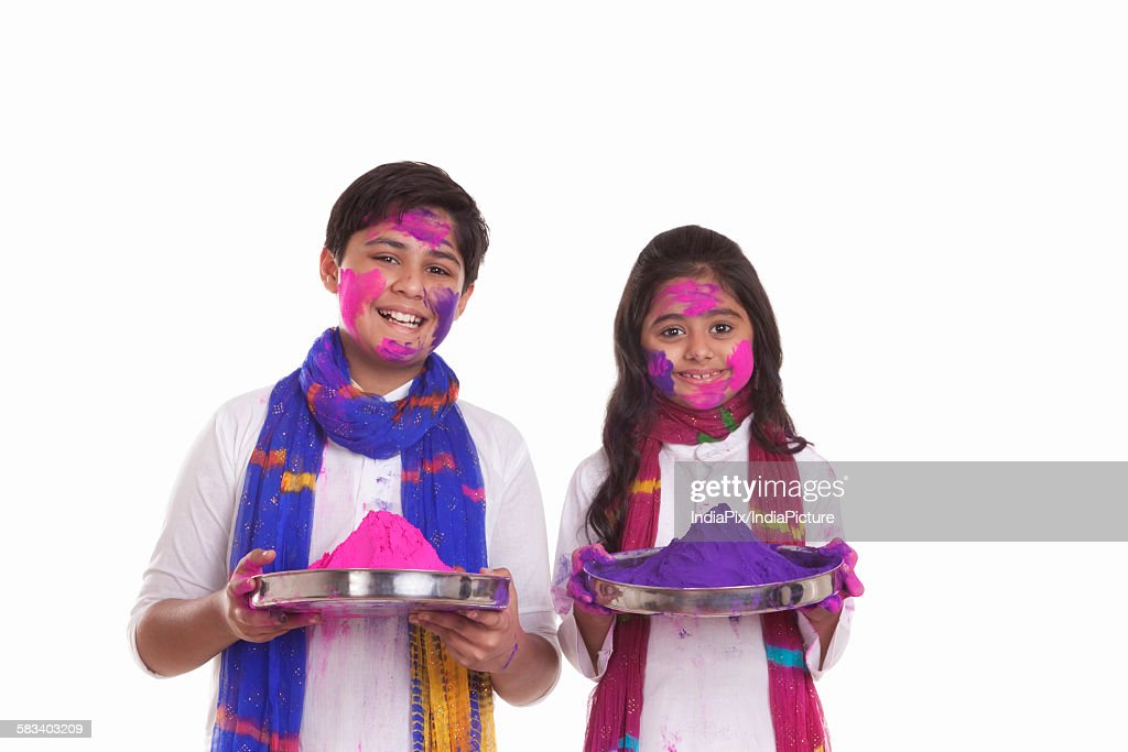 Portrait of a boy and girl with holi colour : Stock Photo