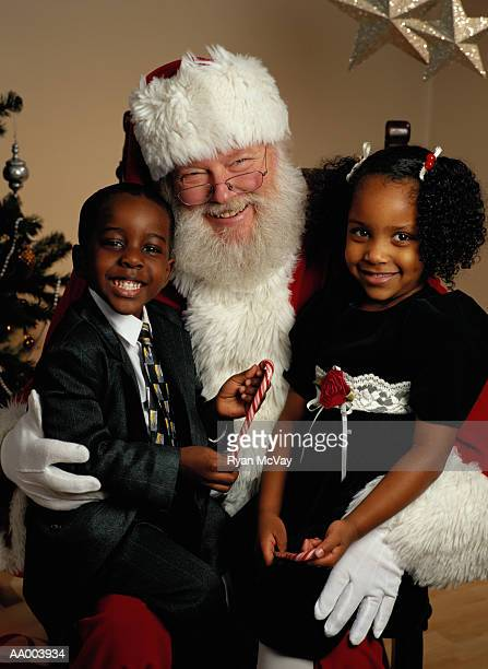 Portrait of a Boy and Girl With Santa Claus