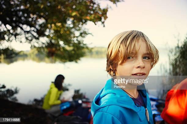 Portrait of a boy at a lake