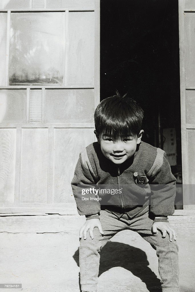 Portrait of a boy at the door : Stock Photo