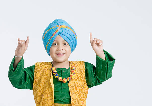 Portrait of a boy doing bhangra and smiling