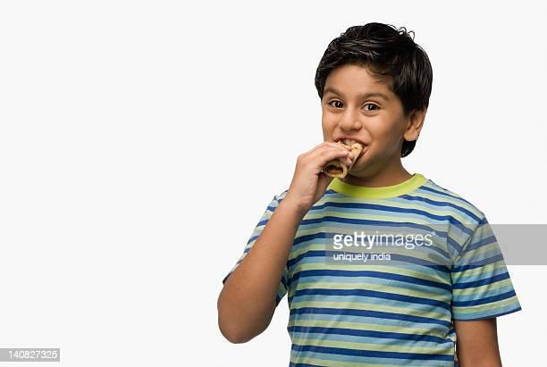 Portrait of a boy eating bread
