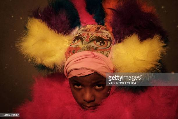 """Portrait of a boy from the """"Sucesso"""" bate-bola street carnival band, during the first day of carnival in Rio de Janeiro, Brazil, on February 25,..."""