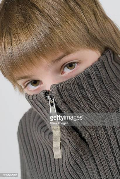 Portrait of a boy hiding his face
