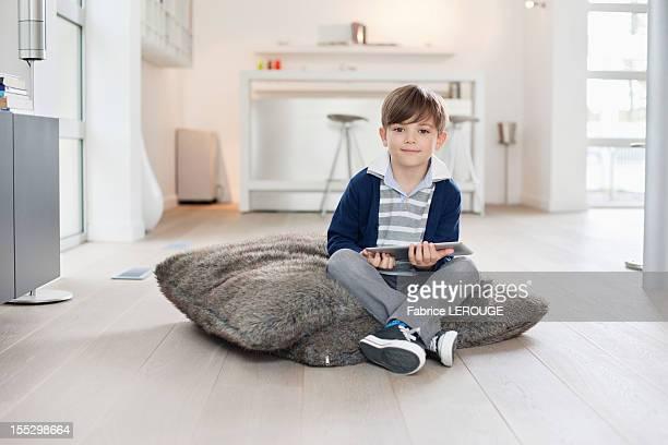 Portrait of a boy holding a digital tablet