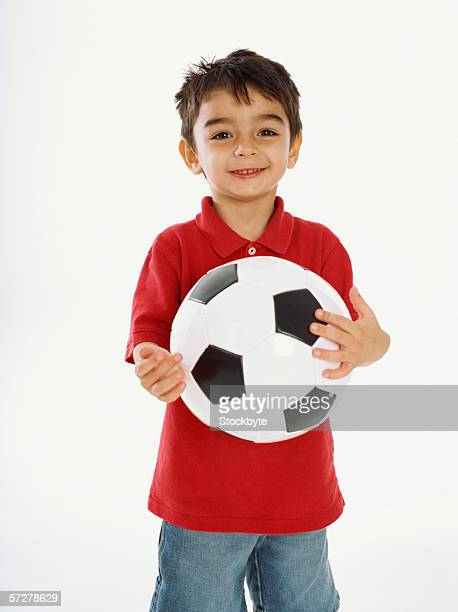 Portrait of a boy holding a football