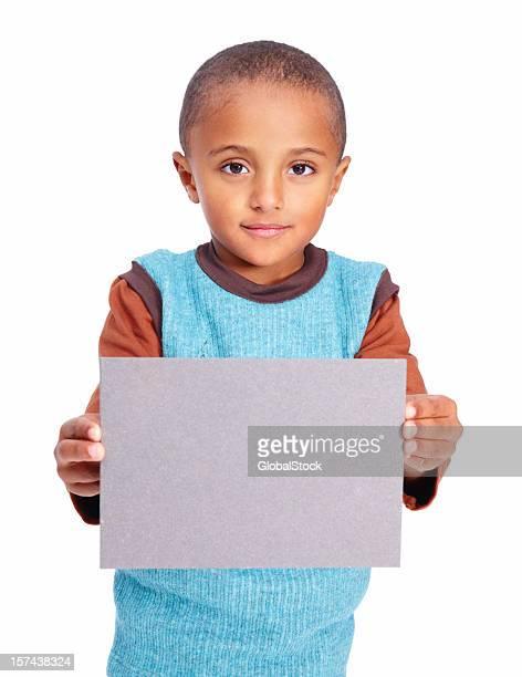 Portrait of a boy holding placard